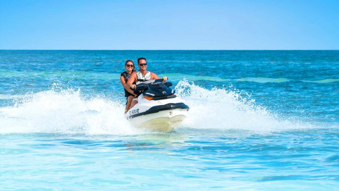 Image of woman jet skiing on the Fury Ultimate Adventure